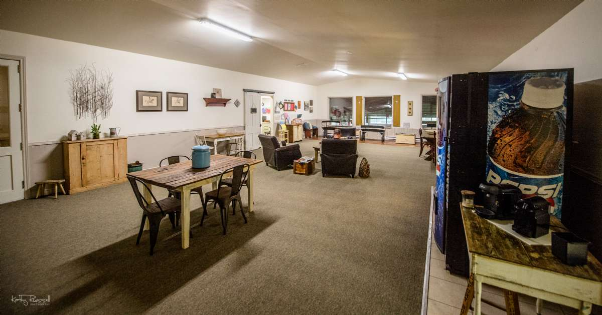 Complete with tables, cozy chairs, viewing benches, bathrooms, and vending machines.  This is a comfortable area for family, friends, and riders to watch lessons, have a snack, use the complimentary wifi, or simply socialize!