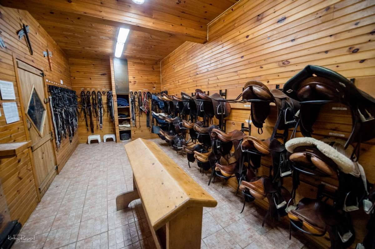 Neat, organized, and clean. Our tack room is well-labelled with equipment for each school horse as well as a tack cleaning station complete with hot and cold running water.